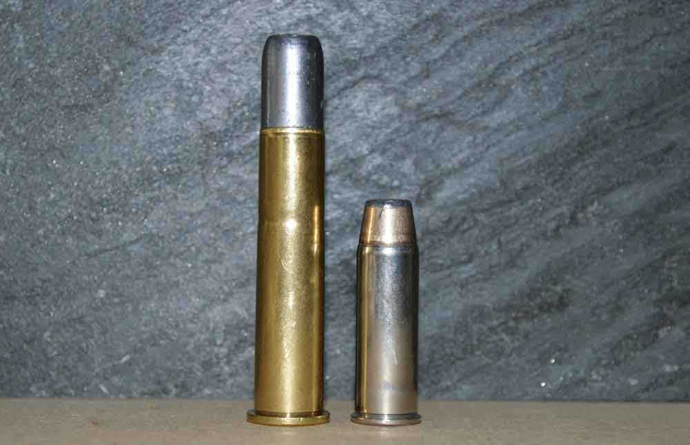 .45-70 Govt. cartridge next to .45 Colt